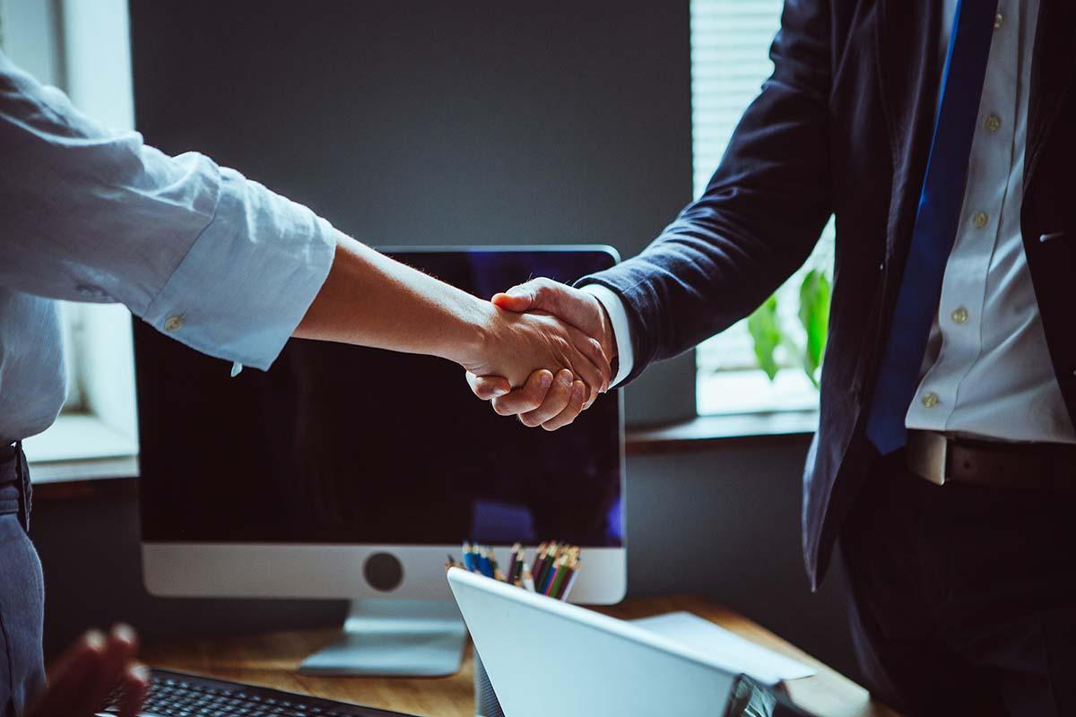 Businessman And Businesswoman Shake Hands